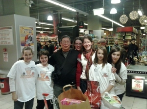 Canadian guy at the food drive with helpers