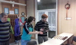 Terbe,J(left) giving a hand